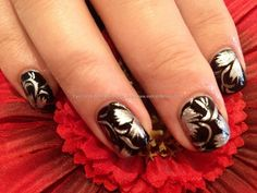 Black and silver freehand nail art