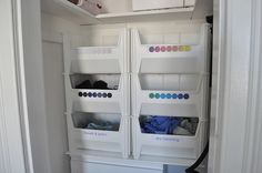 easy laundry organization: stackable recycling bins from the container store that are the perfect size for one load of laundry!