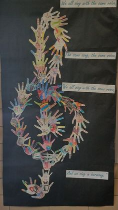 """After learning """"We All Sing With the Same Voice"""" from Sesame Street my kindergartners traced their ha d's and drew pictures of what makes them unique and I created a clef. Turned out better than I expected and was a great hallway decoration Kindergarten Music, Preschool Music, Music Activities, Teaching Music, Preschool Bulletin, Singing Lessons, Music Lessons, Choir Room, Music Bulletin Boards"""