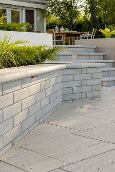 This retaining wall look is inspired by our Raffinato Polished. You are in the right place about L Backyard Retaining Walls, Retaining Wall Design, Concrete Retaining Walls, Retaining Wall Gardens, Stone Retaining Wall, Concrete Patio Designs, Backyard Patio Designs, Backyard Landscaping, Landscaping Ideas