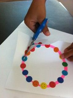 Kids cut through sticker to learn to turn and cut - lots of other great fine motor ideas on this site.