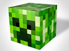 """Minecraft Creeper Head    $18.99 @ www.TheShoppingBagStore.com    Countless hours of Minecraft tend to blur line between reality and voxels.    Toss one of these Steve heads on your melon and pay close attention to the reactions you receive. If you see someone staring at you, rubbing their bloodshot eyes in disbelief, they probably just got off a 16 hour mining bender.    12"""" X 12"""" X 12""""    Cardboard Minecraft Creeper Costume Head"""