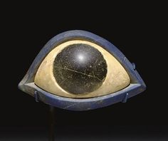 Ca. 2500 BCE statue eye. Thick Lapis Lazuli beveled to hold the white limestone which forms the eye's sclera which is drilled to receive the black stone pupil. Sumerian.