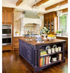 I would love some sort of island in my future kitchen! I can see the kiddos sitting there doing their homework while I/we make dinner! lol