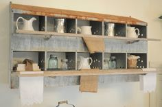 I WANT IT! An old nesting box is used for displaying unique vintage finds in our dining room. A clever way to add a touch of industrial and old farmhouse style to your home.