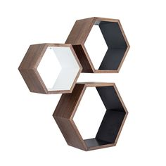 These walnut Nesting Hexagon Shelves are the ultimate stylish yet functional addition to your living space. They offer a surprising amount of space to display your favorite decorative items. Showcasing...  Find the Walnut Nesting Hexagon Shelves - Set of 3, as seen in the Mid-Century's Greatest Hits Collection at http://dotandbo.com/collections/mid-centurys-greatest-hits?utm_source=pinterest&utm_medium=organic&db_sku=HX0002-WGB