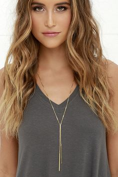 """Never will you ever go accessory-less thanks to the Posh Pair Gold Necklace! Complete all of your chic ensembles with this long snake chain necklace that splits to two slender pendants. Necklace measures 26.5"""" around with a 2"""" extender chain."""