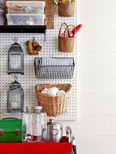 Boarded Up - Pegboard isn't just for hammers and screwdrivers. Outfitted with a combination of hooks and baskets, it can store all of your outdoor party essentials. You can purchase baskets made specifically for pegboard, but any wire, open-weave, or handled basket works—as long as you can hang it on a hook. To hang oversize candle lanterns, use two-prong straight hooks that are slightly longer than the depth of one lantern.