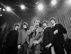 "Almost show time: The Beatles surround Ed Sullivan in a huddle during a rehearsal for their first appearance on ""The Ed Sullivan Show"" on Feb. 9, 1964."