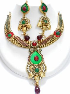 Fiore Polki Jewellery £44  Designer polki necklace set. Red, green and white stones with matching earrings.  - See more at: http://www.jodhascollection.com/shop/necklace/fiore-polki-jewellery-set/#sthash.lPu3mxB4.dpuf
