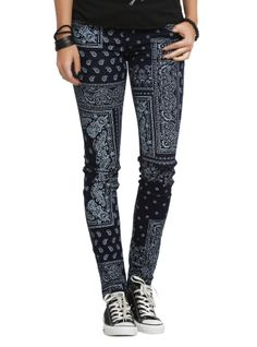 Blue skinny jeans with an allover white paisley print.