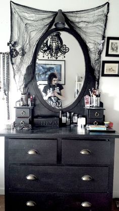 I noticed the mirror in the bedroom (I think). I really like it! Same as the bed concept, we could drape some black fabric around it to make it more of a focal point. Really, adding black lace or tulle to anything will give you the look you're going for.