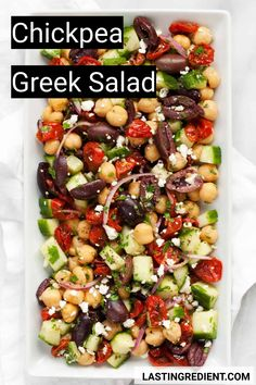 This chickpea Greek salad has the traditional ingredients--tomatoes, cucumbers, & olives. The garbanzo beans make it filling enough to be a vegetarian main. Garbanzo Bean Recipes, Chickpea Recipes, Vegetarian Recipes Easy, Healthy Recipes, Pescatarian Recipes, Healthy Salads, Pea Salad Recipes, Greek Salad Recipes, Whole Food Recipes