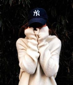 navy blue cap and cream woolly sweater