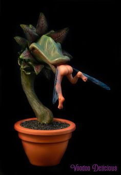 It's a dangerous world out there for a young faery, the savage Venus faery trap is notorious for catching the tiny flying creatures, ooak (one of a kind) sculpture about eight inches tall including the pot made from polymer clay.