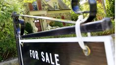 """Canada's housing market has two good years ahead of it yet, Canada Mortgage and Housing Corp. said Monday, with low interest rates and a """"moderately"""" expanding economy keeping price corrections at bay."""