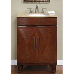 Add a sense of warmth to your bathroom with this wooden single sink cabinet by Silkroad. The cabinet is crafted with a natural stone top and features decorative diamond door accents, brushed silver fixtures, and a ceramic sink for a decorative result.