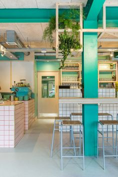 Green column, planting in restaurant, pink tiles, timber, 400 Rabbits Pizza restaurant