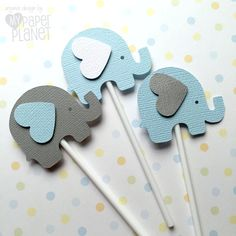 * Handmade in Australia * Blue and grey elephant baby shower theme. A set of 8 elephant-shaped cupcake toppers, my original design, they are precision cut from textured cardstock, with a contrasting heart-shaped ear on one side. They are single sided, and attached to a plastic lollipop