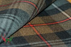 The Robertson Hunting Weathered tartan in heavyweight 16 oz, wool which is ideal for kilts and upholstery work.