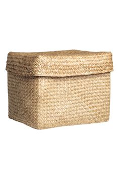 Natural. Storage basket in braided seagrass. Lid with handle at top. Size 9 3/4 x 9 3/4 x 11 3/4 in.