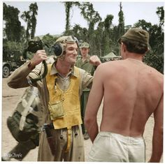 Ens. Andy Jagger describes kill made over Rabaul To Lt. H.A. March at Bougainville Airstrip. Pilots Are Of Vf-17 Squadron. Feb. 1944