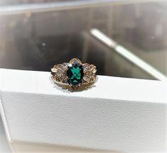 9x8mm green Tourmaline with side diamonds. 14k yellow gold $1,295.00