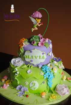 Tinker Bell Fantasy Garden Two Tier - Two tier 6 & 10 covered in fondant with fondant & gumpaste flowers. Topper provided by customer. Thanks for looking!
