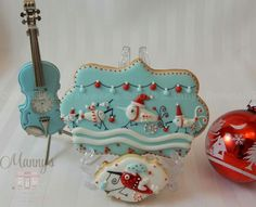 Manny's Cookies:  Mosquitos for Christmas.   (I love the tiny violin!)