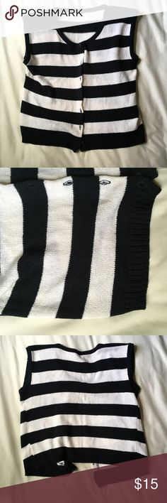 Black and White Stripe Knit Button Down Tank This black and white striped knitted tank top is a button down and adorable. No brand, size L, and would look beautiful open or buttoned down over some skinny jeans. Love this item, but not the price? Make me an offer! Or save by bundling another item in my closet! I would love to make you a special offer. Happy Poshing! Tops Tank Tops