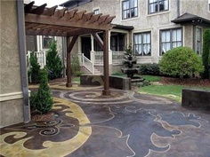 Custom stained and engraved patio creates artistic piece outdoors.  Concrete Mystique Engraving Nashville, TN