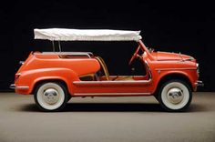 Fiat Jolly. It's the wicker seats and picnic basket in the trunk...just beyond adorable