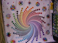 I think I'd like it better without the stars. Rainbow swirl quilt --  From the Lancaster Quilt Show