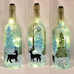 Painted wine bottle of deer, painted lighted bottle, bottle lamp Wine Bottle Art, Glass Bottle Crafts, Painted Wine Bottles, Lighted Wine Bottles, Bottle Lights, Bottle Bottle, Liquor Bottles, Glass Bottles, Decorated Bottles