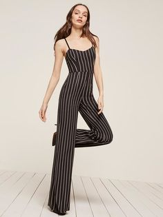 Suit yourself. This is a full length jumpsuit with a slim fitting bodice, a wide leg and a center back zipper. http://bit.ly/2o9MKJv