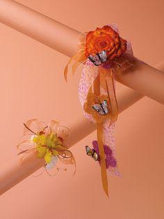 Circus Rose & Buttlerflies wrist corsage (upper right) Yellow Ocidium Orchid wrist corsage ( bottom left)