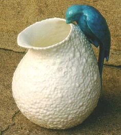 English majolica pottery pitcher with parrot  http://archives.porcelain.oneofakindantiques.com/1307_english_majolica_pottery_pitcher_with_parrot_1.htm#