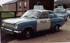 Visit this page for information about the Ford Taurus Police Interceptor, and the engine and powertrain of this unique Ford vehicle Escort Mk1, Ford Escort, American Graffiti, Ford Classic Cars, Classic Trucks, Harrison Ford, British Police Cars, British Car, Emergency Vehicles