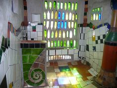 Hundertwasser toilets / Kawakawa love the light through the bottles.