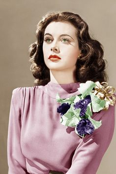 Hedi Lamarr, 1941 Actress Hedi rocks a huge floral corsage for Come Live With Me. So this is where Carrie Bradshaw got her inspiration from...