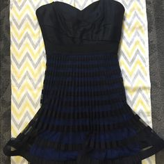 Strapless cocktail dress Gorgeous little black cocktail dress with a pop of blue. This was only worn once for a wedding. It does come with straps and can be worn either that way or strapless. Tight fitted top with a slim blue lace trimmed slip underneath and a cool overlay skirt. Reasonable offers considered the tough offer button BCBGMaxAzria Dresses