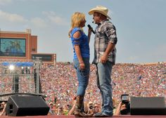 Trisha Yearwood, left, and Garth Brooks perform during the Oklahoma Twister Relief Concert to benefit United Way of Central Oklahoma May Tornadoes Relief Fund at Gaylord Family Oklahoma Memorial Stadium on July 6, 2014 in Norman, Oklahoma.