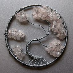 "Silver wire tree with crystal beads mounted on a chunk of crystal rock. Tree including base is 4"" tall. This was a real challenge for me but I'm very happy with the way it turned out. I wish t..."