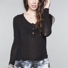Brandy Melville long sleeve top This black long sleeve top is in great condition! 3 buttons in the front make it adjustable, and the top has extra long sleeves Brandy Melville Tops