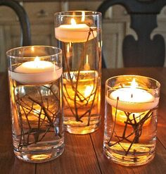 DIY Wedding Table Decoration Ideas  tall candle pillars with flowers inside and short mason jars with simple flowers. These will cluster in center of table on top of burlap