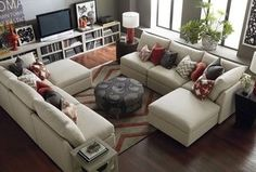 Contemporary Living Room with Hardwood floors, Bassett Mizuki Copper Accent Pillow, Window seat, Built-in bookshelf