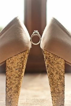 Ring between wedding shoes makes for a fun wedding photo