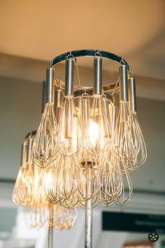 Repurposed wire whisks; Whisk Chandelier light fixture by Estate ReSale & ReDesign, Bonita Springs, FL