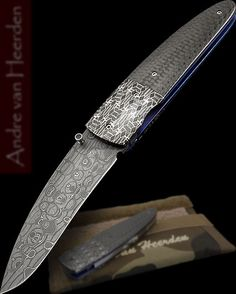Andre Van Heerden Custom Knive Damascus Carbon Fiber.  Based in Pretoria, South Africa.  Blade Length 	70mm (2¾in)  Blade Material   Damascus  Handle Material   Mosaic damascus and carbon fiber  Lock Type   Linerlock  Overall Length   165mm (6½in)