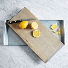 West Elm Ash + Steel Serving Tray ($99) - Let's take a quick stock of this epic picnic: There's fancy cheese, all out cocktails and probably a few more bells and whistles in that basket. Give the spread a proper home.